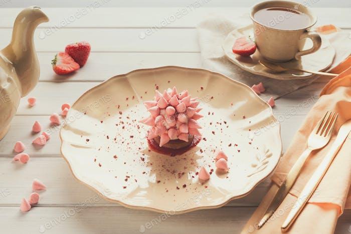 Pink restaurant dessert on porcelain plate