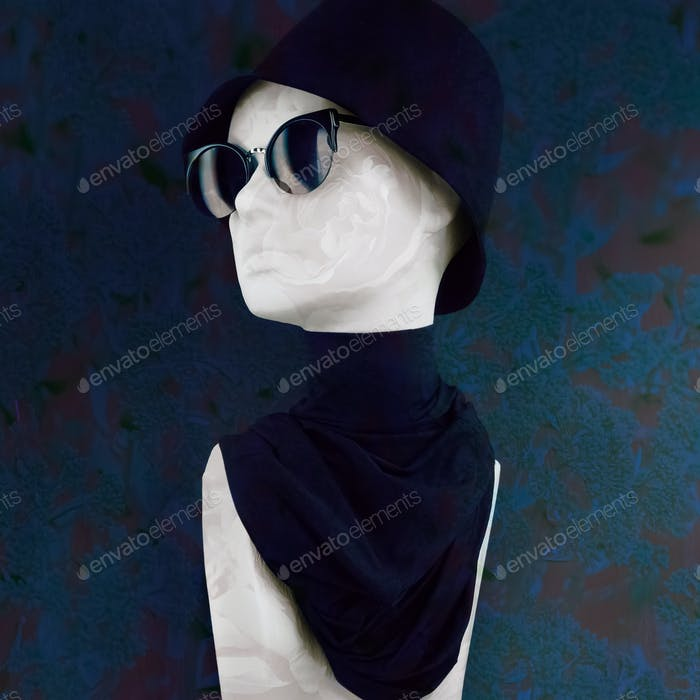 Mannequin Wearing Black Hat Sunglasses and Scarf