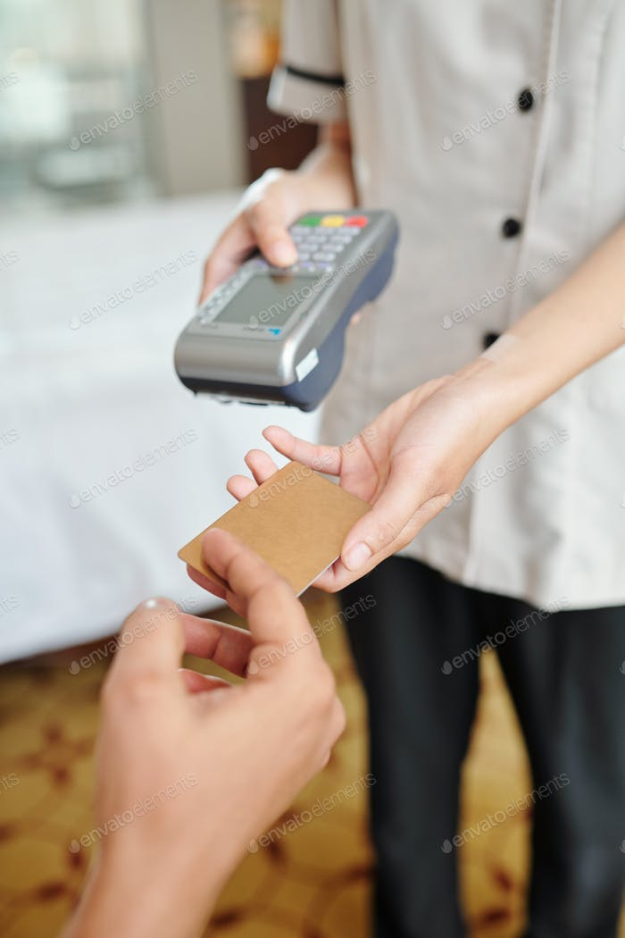 Hotel maid with payment terminal
