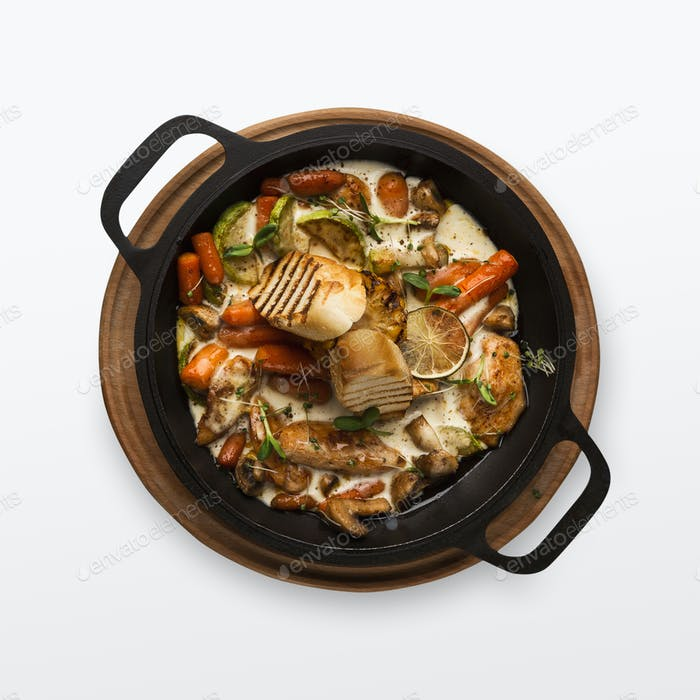 Chicken and vegetables stewed in pot, isolated on white