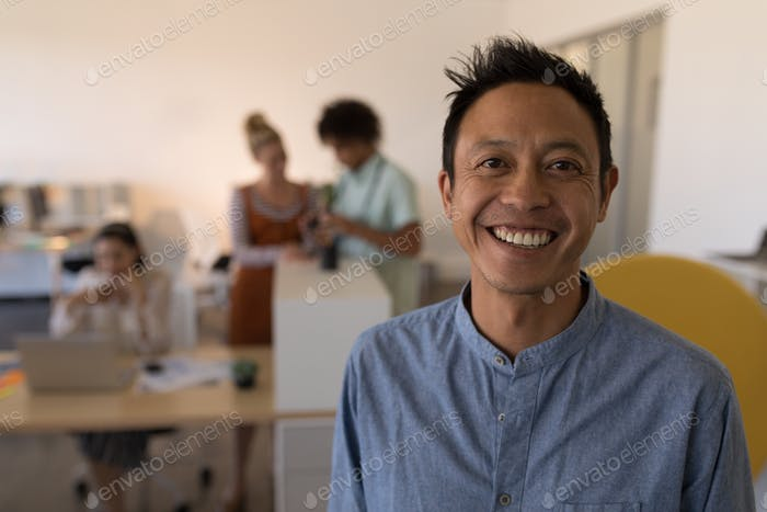 Businessman looking at camera in modern office