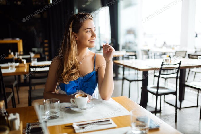Beautiful woman enjoying her coffee