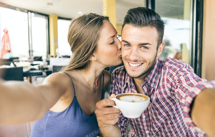 Couple taking selfie at breakfast time