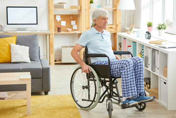 Disabled man in domestic room