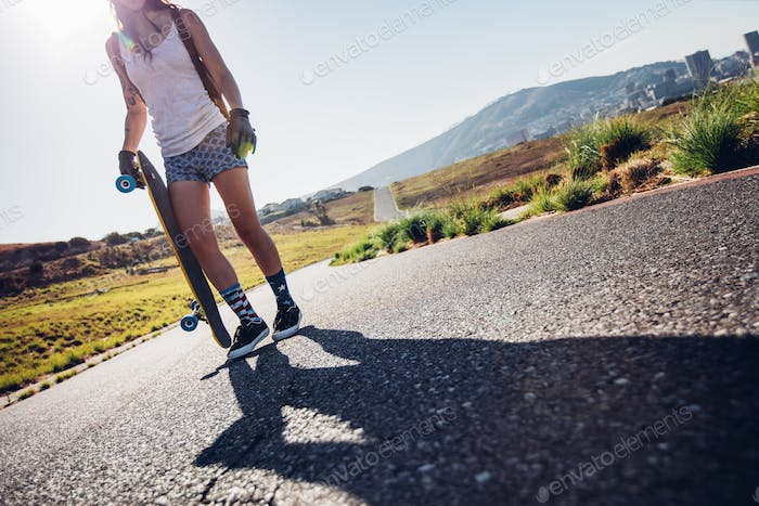 Woman ready to go longboarding
