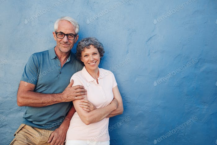 Happy mature couple standing together