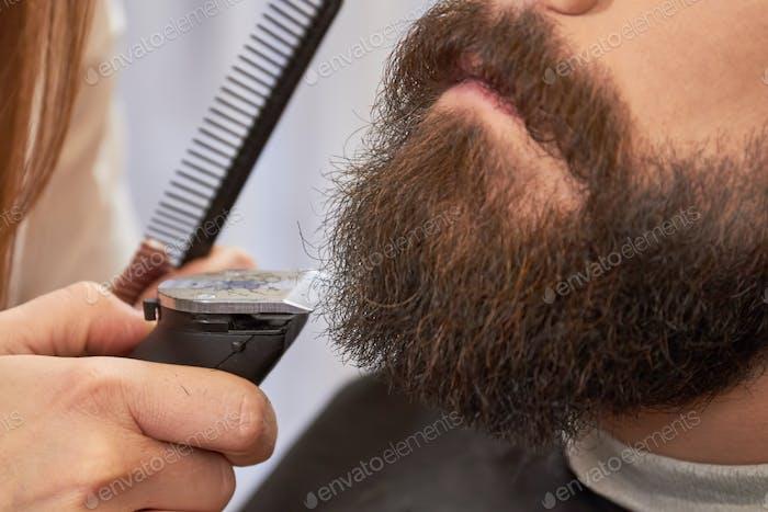 Beard trimming close up