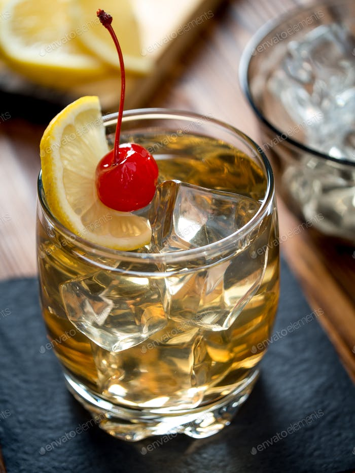 Glass of whiskey sour cocktail