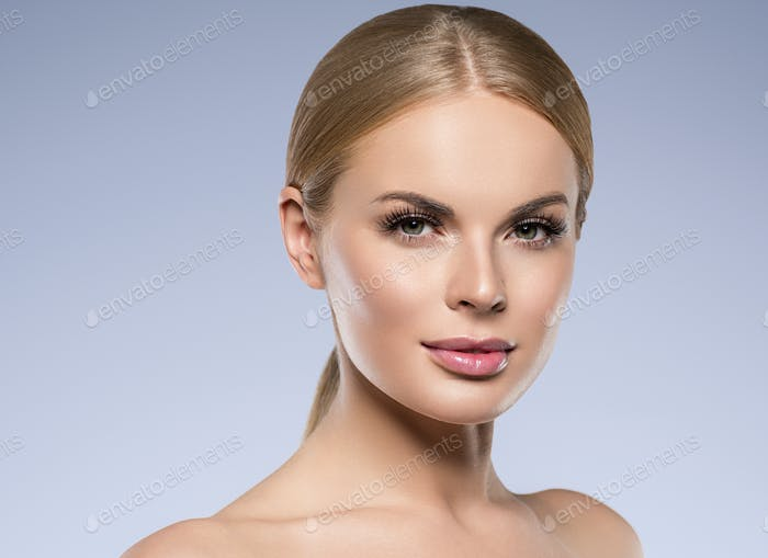 Beautiful woman blond with long hair natural makeup and healthy skin cosmetic concept