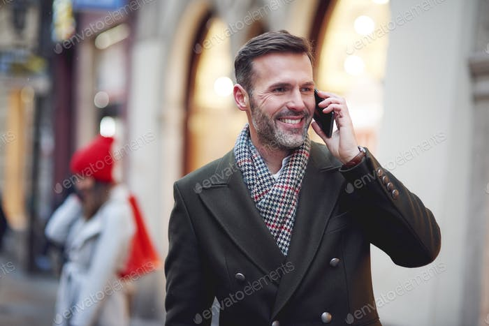 Smiling man is on the phone