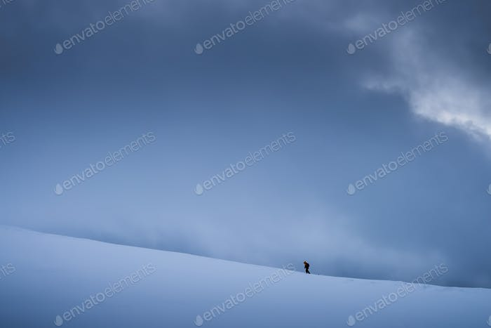 Trekker walking towards Storsteinen mountain summit
