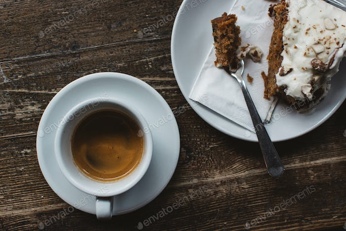 Having espresso with carrot cake