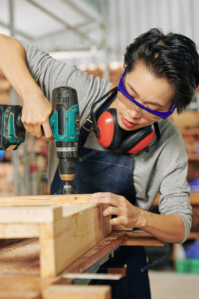 Carpenter working with cordless screwdriver