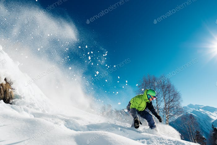 snowboarder is landed on snowboard