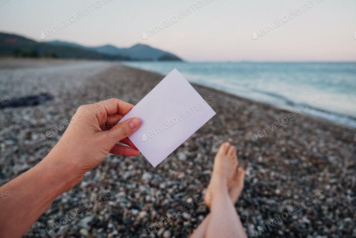 Empty paper note in hand