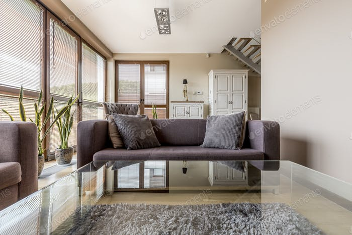 Elegant living room with glass coffee table