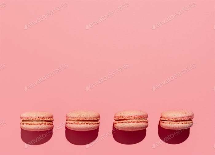 Macarons on pink, copy space, hard light