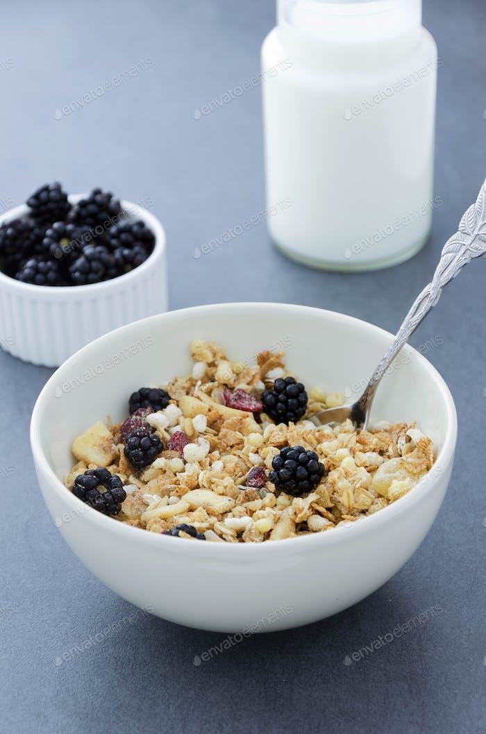 Cereal bowl, milk bottle and blackberries