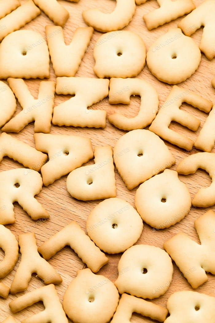 Letter Biscuit over the wooden table