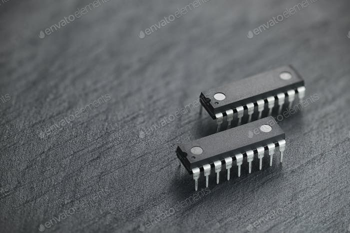 Integrated circuit chip on black slate rock background