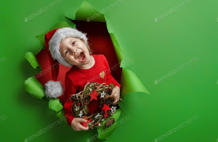 girl in Santa's hat on bright color background