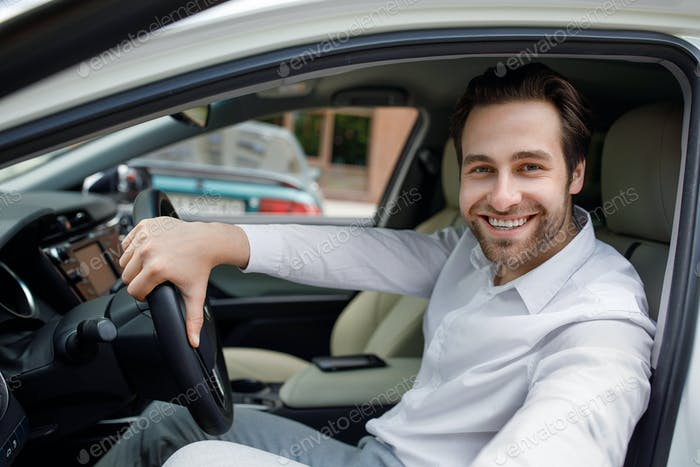 Automobile trading, rental and buy in car dealership, positive expression and good driver in city