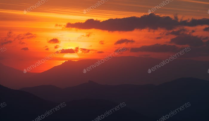 Sunset in the mountains. Rocks of South Demerdzhi at sunset