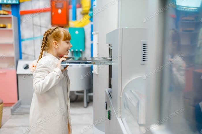 Little girl playing doctor in analysis laboratory