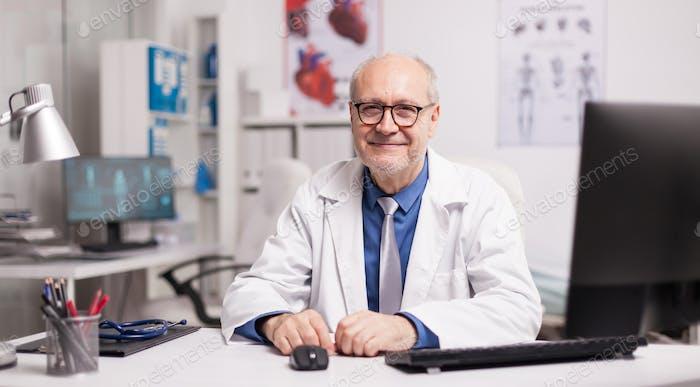 Mature doctor wearing eyeglasses