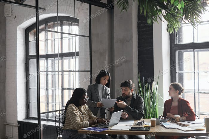 Diverse Group of Business People at Meeting Table
