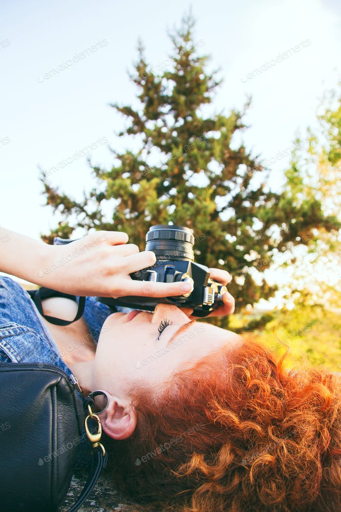 young redhead photographer having a great time