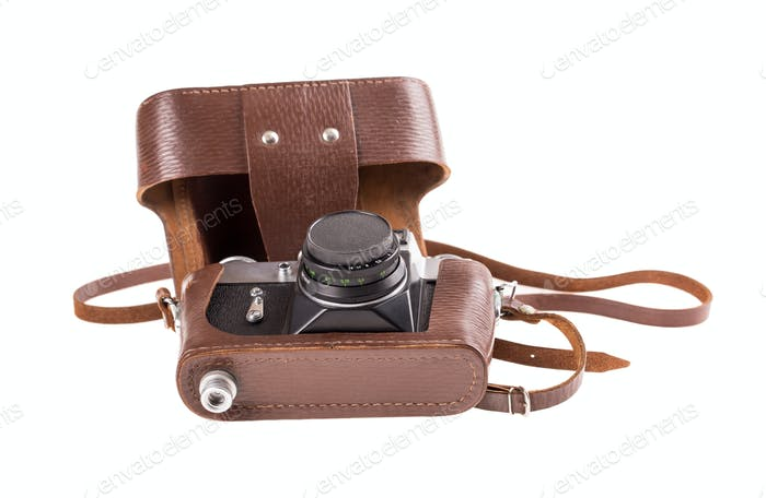 Old metal photo camera in leather case.