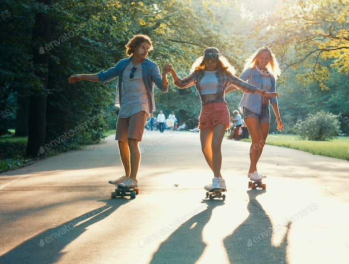 Young skateboarders in the summer park