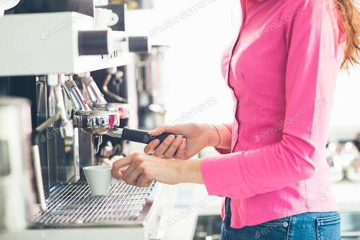 Waitress making coffee