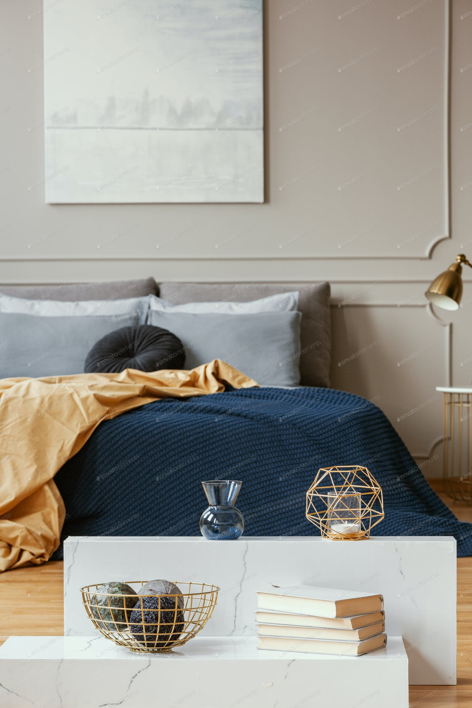 Vertical view of elegant blue, grey, gold and orange bedroom photo by  bialasiewicz on Envato Elements