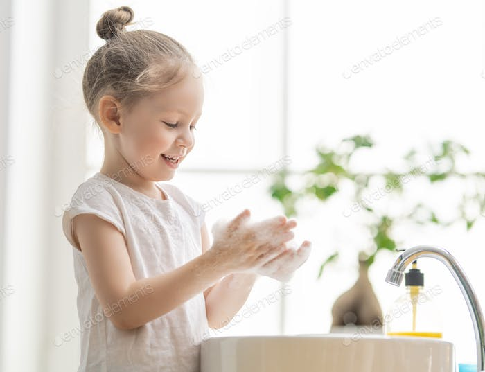 girl is washing hands