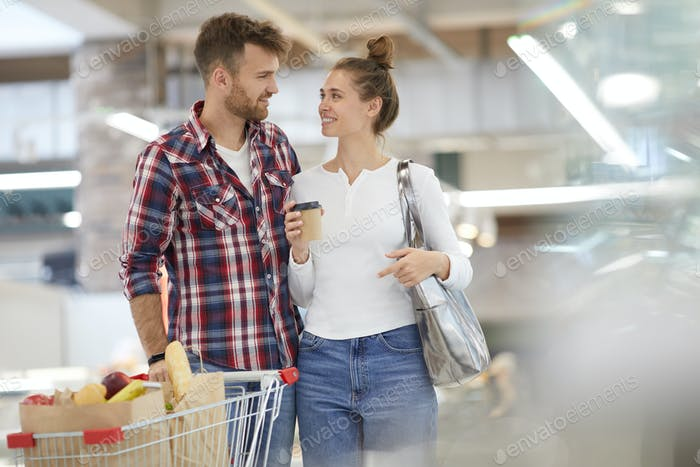 Happy Couple Carrying Groceries