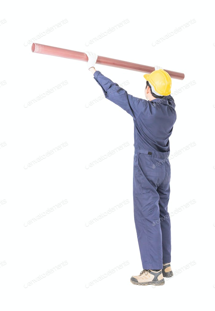 Plumber in uniform holding pvc pipe with clipping path 4