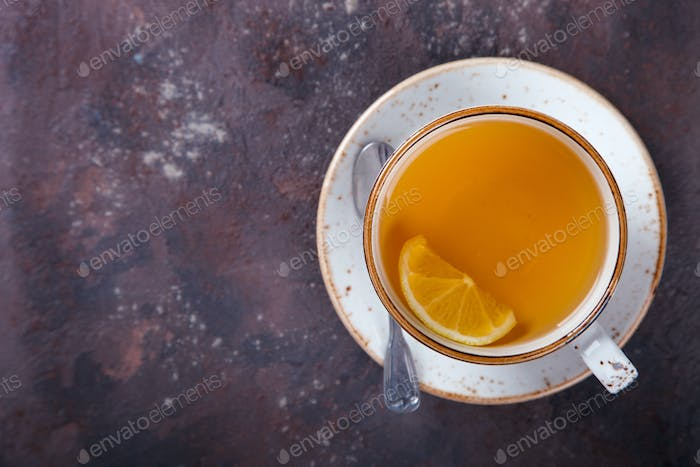 Cup of tea on a dark background.