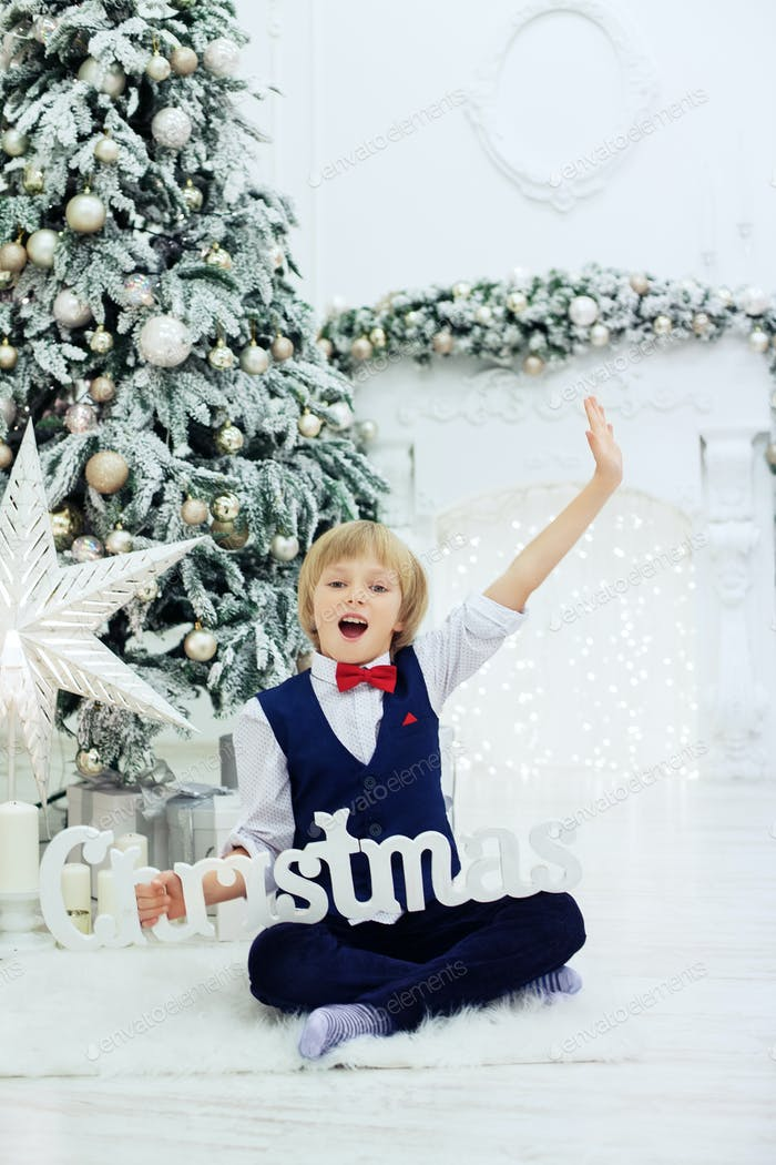 little boy greets holidays. The concept of Christmas