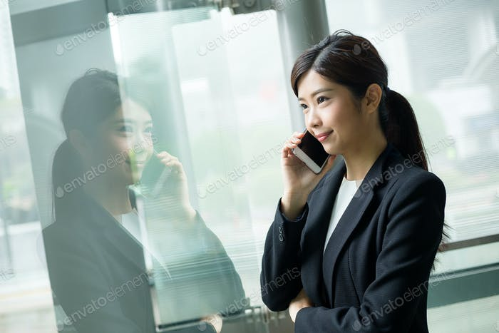 Corporate worker talking on mobile phone