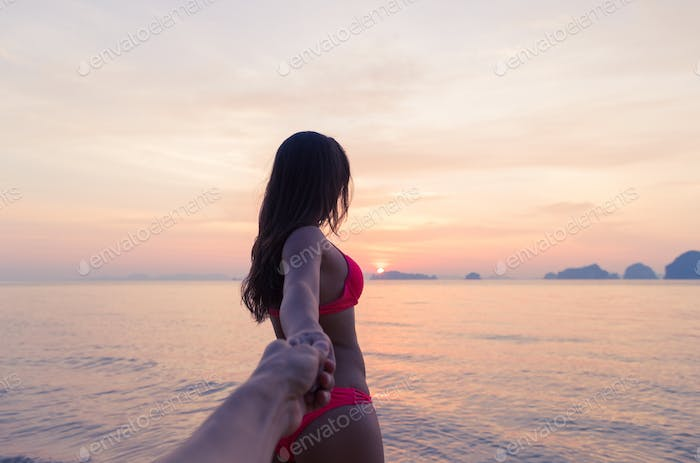 Woman Hold Man Hand Walking On Beach At Sunset, Young Tourist Couple On Sea Holiday