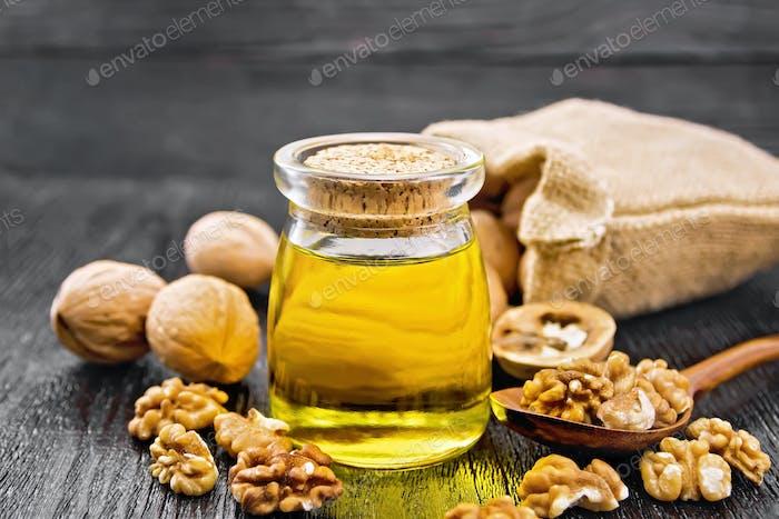 Oil walnut in jar on board