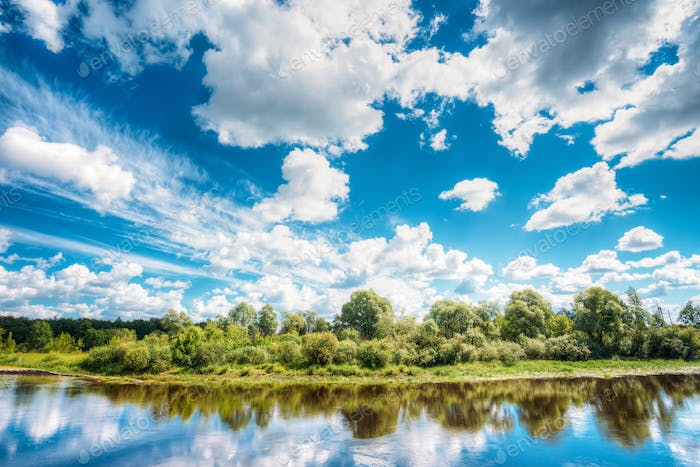 River Landscape With Reflections Of Clouds And Woods In Water. S