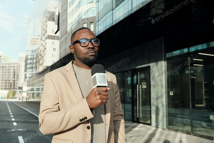African reporter working outdoors