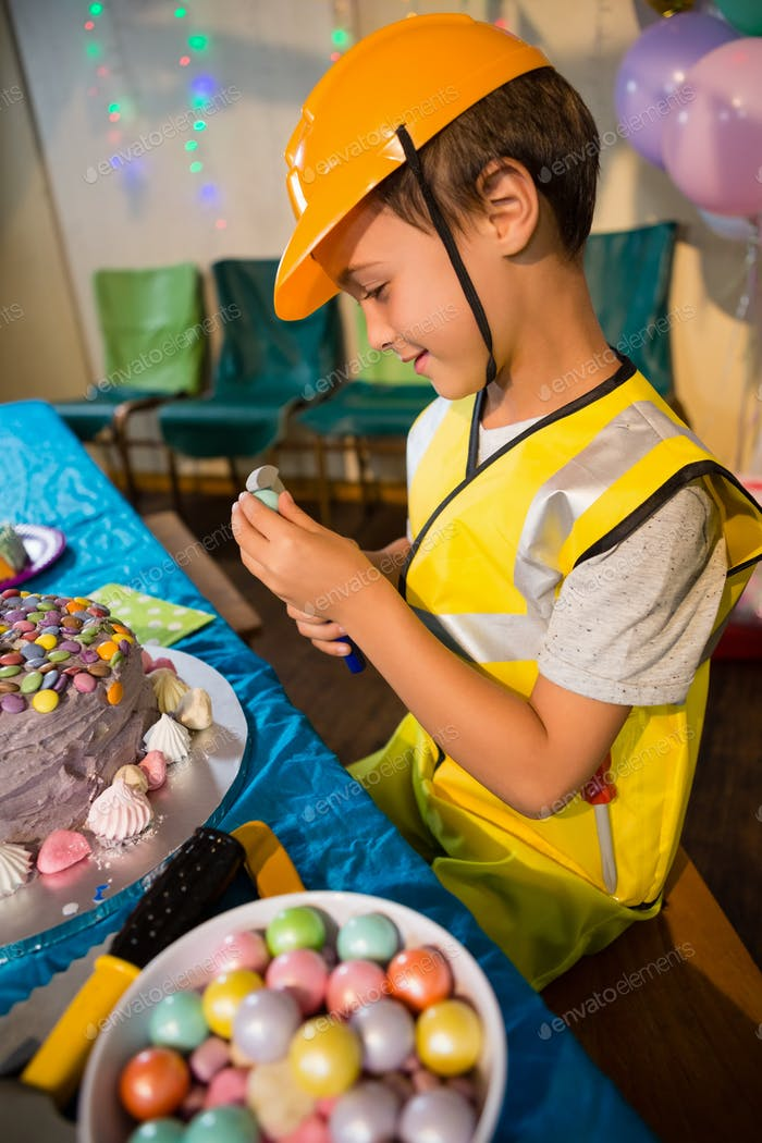 Boy pretending as a worker during birthday party
