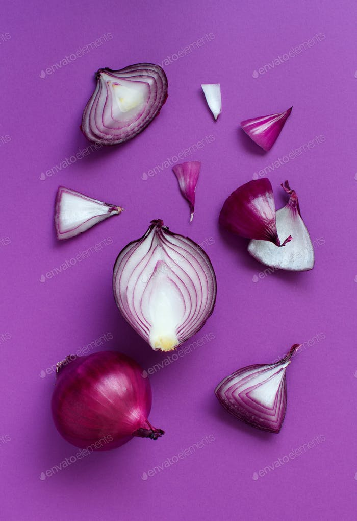 Purple onion on a purple background top view