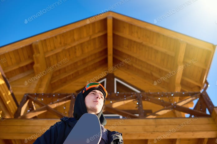 Snowboarder Leaving Chalet House