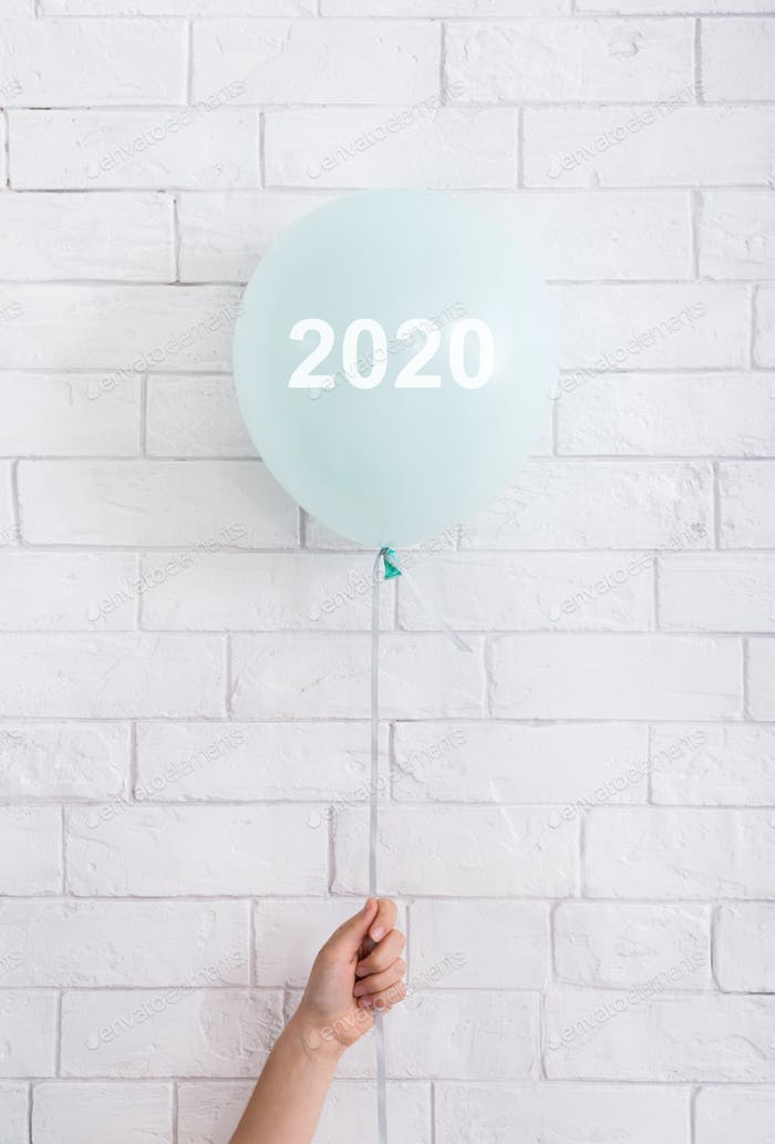 Blue helium balloon with white text in woman hand