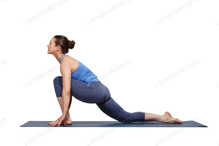 Woman doing Hatha yoga asana Anjaneyasana
